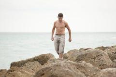 Man walking on the rocks Royalty Free Stock Images