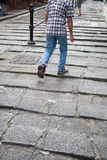 Man walking the rocky steps. Man walking up the rocky steps Stock Photo