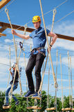 Man walking on a rope ladder Royalty Free Stock Photography