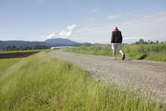 Man Walking Rural Dyke Royalty Free Stock Photo