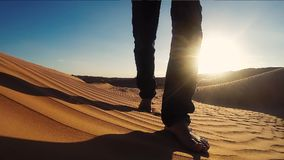 Man Walking on a Sahara Desert Dune close up stock video footage