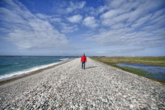 Man walking at the sea side Royalty Free Stock Image