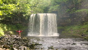 Man walking by Sgwd yr Eira Waterfall, Brecon Beacons National Park stock video