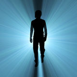 Man walking shadow light flare Royalty Free Stock Image
