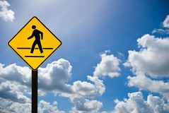 A man walking sign with cloudy sky Stock Photo