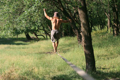 Man walking on slackline Royalty Free Stock Images