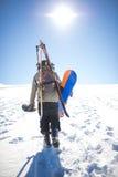 Man walking on snow Royalty Free Stock Photos