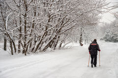 Man walking on snow with Stock Image