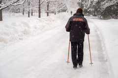 Man walking on snow Stock Photography