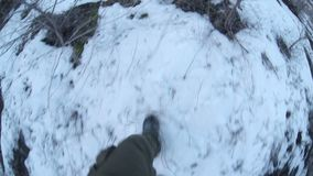 Man walking on snow and dry grass journey legs in stock footage