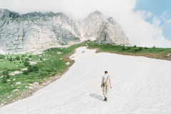 Man walking on snow in the mountains Royalty Free Stock Photography
