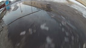 Man walking on snow and mud early spring gopro stock video