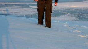 Man walking through snow stock video footage
