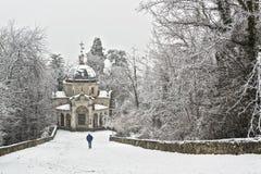 Man walking in the snowfall Stock Photos