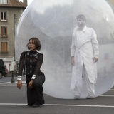 Man walking in a sphere. AURILLAC, FRANCE- AUGUST 18: Aurillac International Street Theater Festival, Cie Jimyprod,a woman is dancing and a man is walking in a royalty free stock photo