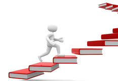 Man walking on the stairs of books Royalty Free Stock Photo