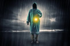 Man walking in storm with lantern Stock Photography