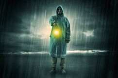 Man walking in storm with lantern. Raincoated man walking in storm with glowing lantern in his hand vector illustration