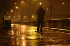 Man walking on street. In Budapest by night Royalty Free Stock Images