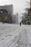 Man Walking in the Street After a Blizzard Stock Images