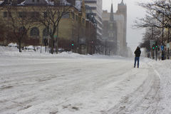 Man Walking in the Street After a Blizzard Royalty Free Stock Images