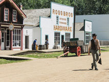Fort Edmonton, Alberta, Canada. Man in vintage costume walking through old west town of Fort Edmonton, Alberta, Canada on sunny day Stock Photo