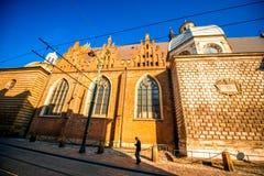 Man walking the street near church in Krakow Royalty Free Stock Photos
