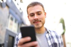 Man walking in the street using a smart phone royalty free stock photos