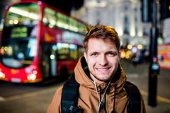 Man walking in the streets of London at night Royalty Free Stock Images
