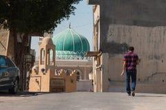 Man walking in streets of Tarout, Saudi Arabia Royalty Free Stock Images