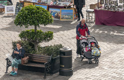 Man walking with a stroller a child Royalty Free Stock Image