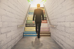 Man walking on suitcase stairway concept Stock Image