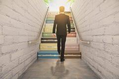 Man walking on suitcase stairway concept Stock Image