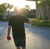 Man walking with sun ray Stock Image