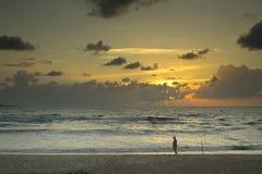 Man walking in sunset Stock Photography
