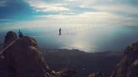 Man walking suspension bridge to Cross in Crimea. Ay Petri stock video