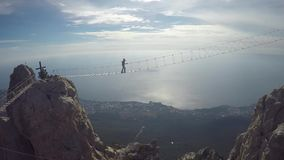 Man walking suspension bridge to Cross in Crimea. Ay Petri stock video footage