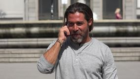 Man Walking While Talking On Phone stock footage