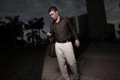 Man walking and texting Royalty Free Stock Photography