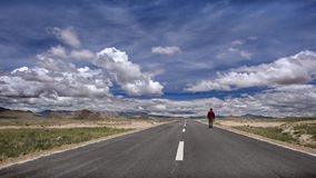 A man walking on the tibetan road Stock Image