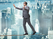 The man walking in tight rope blindfold Stock Photos