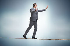 The man walking in tight rope blindfold. Man walking in tight rope blindfold Stock Images