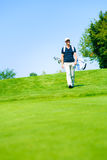 Man Walking To His Golf Ball Royalty Free Stock Photography