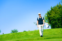 Man Walking To His Golf Ball Royalty Free Stock Image