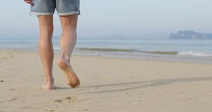 Man Walking To Water On Beach, Male Legs Closeup Back Rear View stock video footage