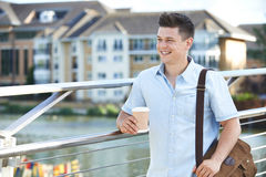 Man Walking To Work In Urban Setting Stock Images