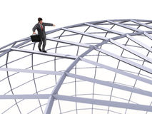 Man walking on top of the sphere Stock Image