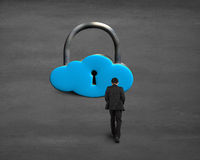 Man walking toward cloud shape lock Stock Images