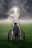 Man walking toward success door at sky Royalty Free Stock Photography