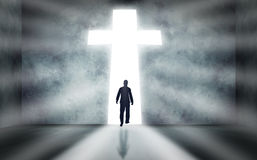 Man Walking Towards Cross Stock Photo
